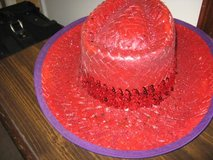 Red straw hat with purple trim in Fort Benning, Georgia