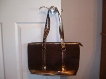 Brown and bronze suede purse in Fort Riley, Kansas